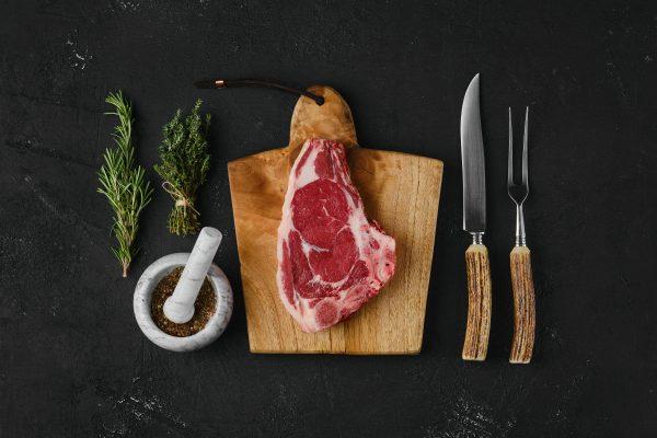 Top view of raw strip steak bone in